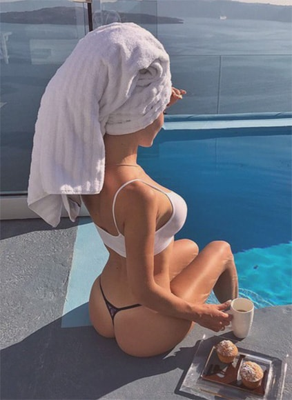 Istanbul VIP escort amazing puss is showing her slim legs, figurate ass, and she's having cupcakes with a black tea or a coffee sitting by the pool immersing her legs in the water