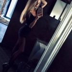 Istanbul escort girl Ulyana is taking a selfie in a big mirror of a big house