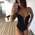 Istanbul VIP escort bayan Radmila takes a selfie in a mirror standing on a wooden floor